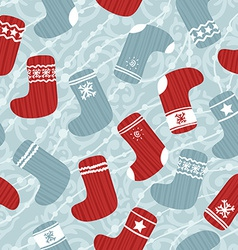Seamless Christmas pattern with stockings vector image