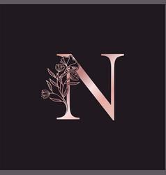 Gold rose flower letter n luxury logo elegant vector