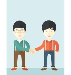 Two asian guys happily handshaking vector