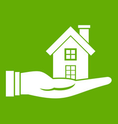 house in hand icon green vector image