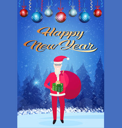santa claus holding gift box sack happy new year vector image