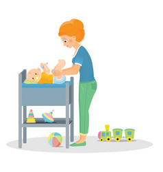 mom changes a diaper to a newborn vector image vector image