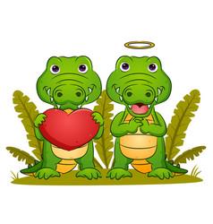 Couple crocodiles is holding big vector
