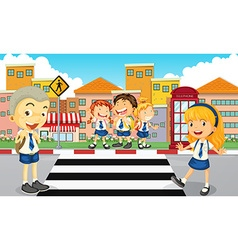 Students crossing the road vector image