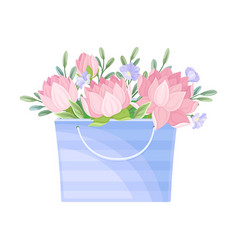 Floral arrangement with lotus in box vector