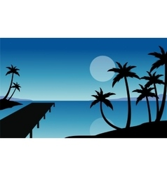 Silhouette of palm and pier scenery vector image