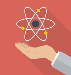 Hand holding atom symbol vector image
