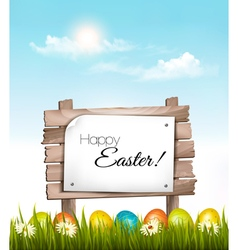 Happy Easter background Easter eggs and wooden vector image