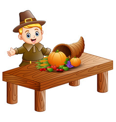 Pilgrim boy with cornucopia of fruits and vegetabl vector