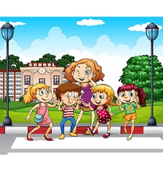Kids and teacher at school ground vector