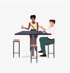 Mix race couple sitting at cafe table man woman vector