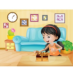 A lady opening her gift in the living room vector image vector image