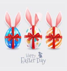 easter eggs and rabbit ears with red ribbon vector image