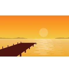 Silhouette of pier at sunset scenery vector image