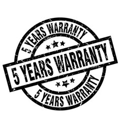 5 years warranty round grunge black stamp vector image
