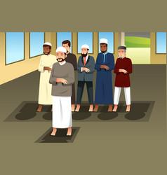 Muslim men praying in mosque vector