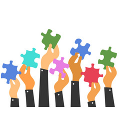 hands holding puzzles vector image vector image