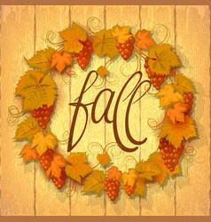 wreath autumn grape leaves on a dark wood vector image
