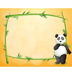 A panda standing at the right side of a bamboo vector image