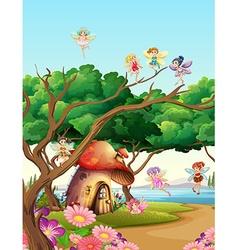 Fairies flying in the garden vector image