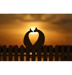 Cats in love silhouette on the fence in sunset vector