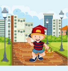 happy boy with vegetabale basket in park vector image