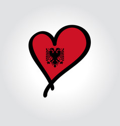 albanian flag heart-shaped hand drawn logo vector image