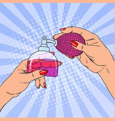 Pop art woman hands holding bottle of perfume vector