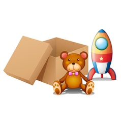 Two toys beside a box vector image