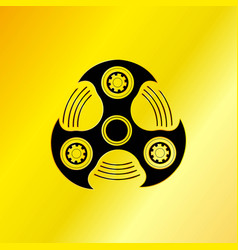black hand spinner emblem with golden background vector image