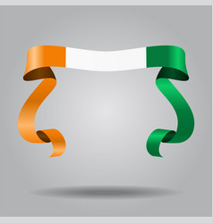 Ivorian flag wavy ribbon background vector