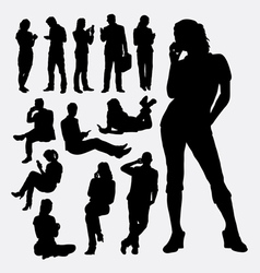 Male and female people with mobile phone silhouett vector image