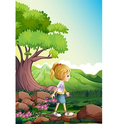 A girl walking above the rocks in the forest vector