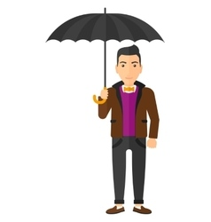 Businessman standing with umbrella vector image