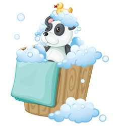 A panda toy and a rubber duck inside a pail vector