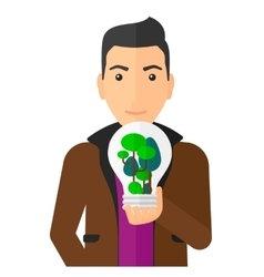 Man with lightbulb and trees inside vector image