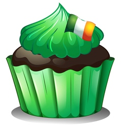A green cupcake with the flag of Ireland vector image