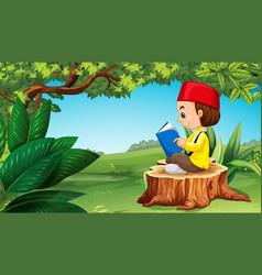 Muslim boy reading book in park vector