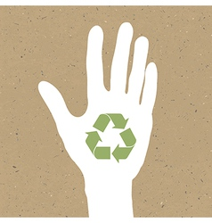 Reuse sign on hand silhouette on recycled paper E vector image