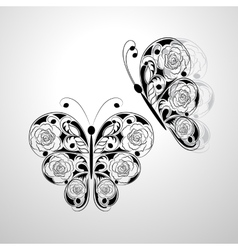 Two batterflies with floral black pattern vector