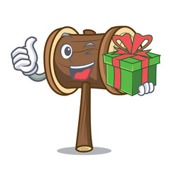 With gift mallet mascot cartoon style vector