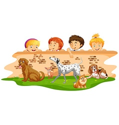 Children looking at dogs over wall vector