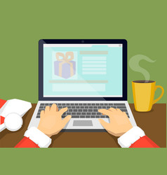 santa chooses gifts on the internet vector image