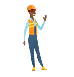 Young african-american builder waving her hand vector