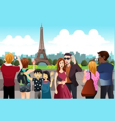 tourists taking picture near eiffel tower vector image