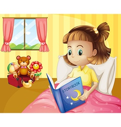 A small girl reading a storybook inside her room vector