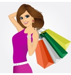 smiling young woman with shopping bags vector image