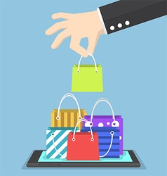 Businessman hand picking shopping bag on tablet vector