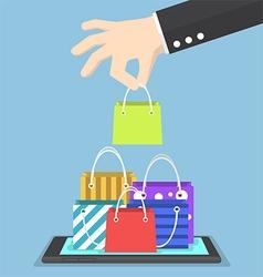 Businessman hand picking shopping bag on tablet vector image