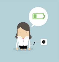 Businesswoman feeling tired and charging battery vector